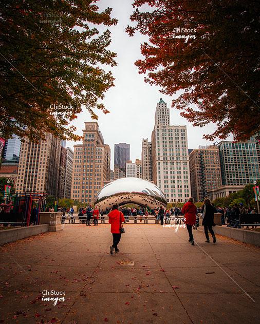 People walking around the Cloud Gate public sculpture, AKA the Bean, Millennium Park Downtown loop Chicago