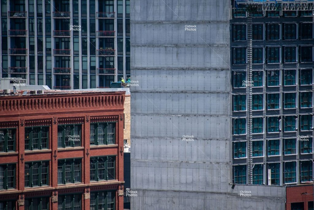 West Loop Chicago New Construction Worker Surrounded by Windows