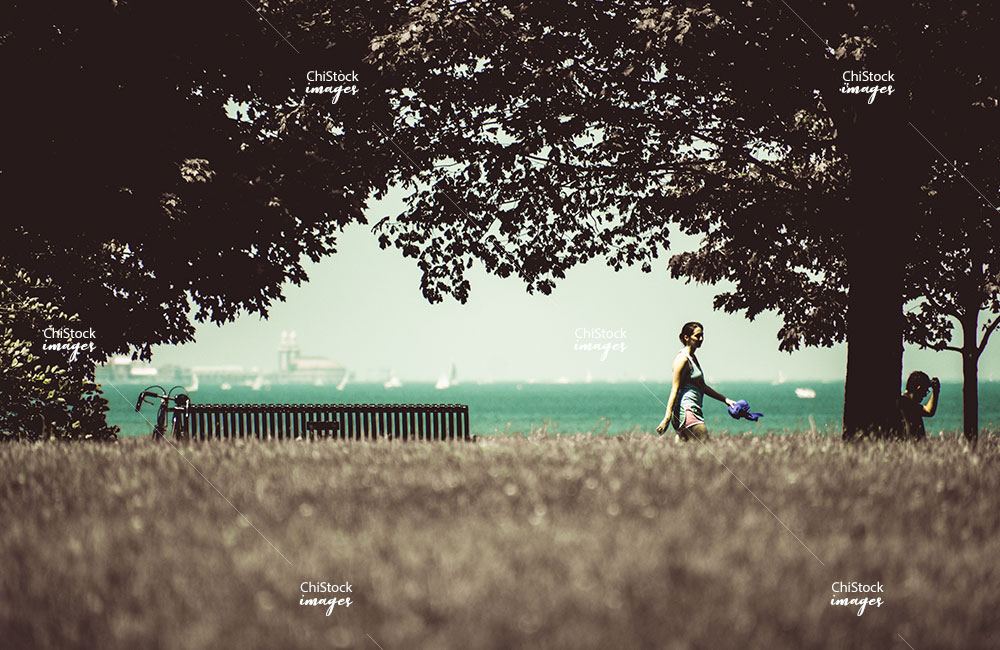 Runner On Promontory Point Peninsula Hyde Park With Navy Pier In The Background