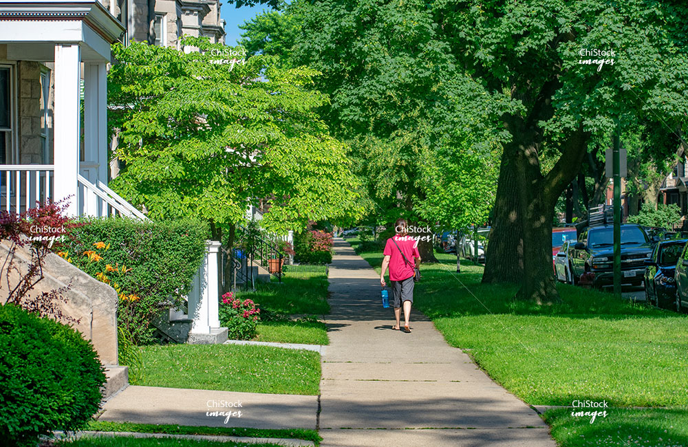 Lincoln Square Neighbor Walking Down Side Street In Summer
