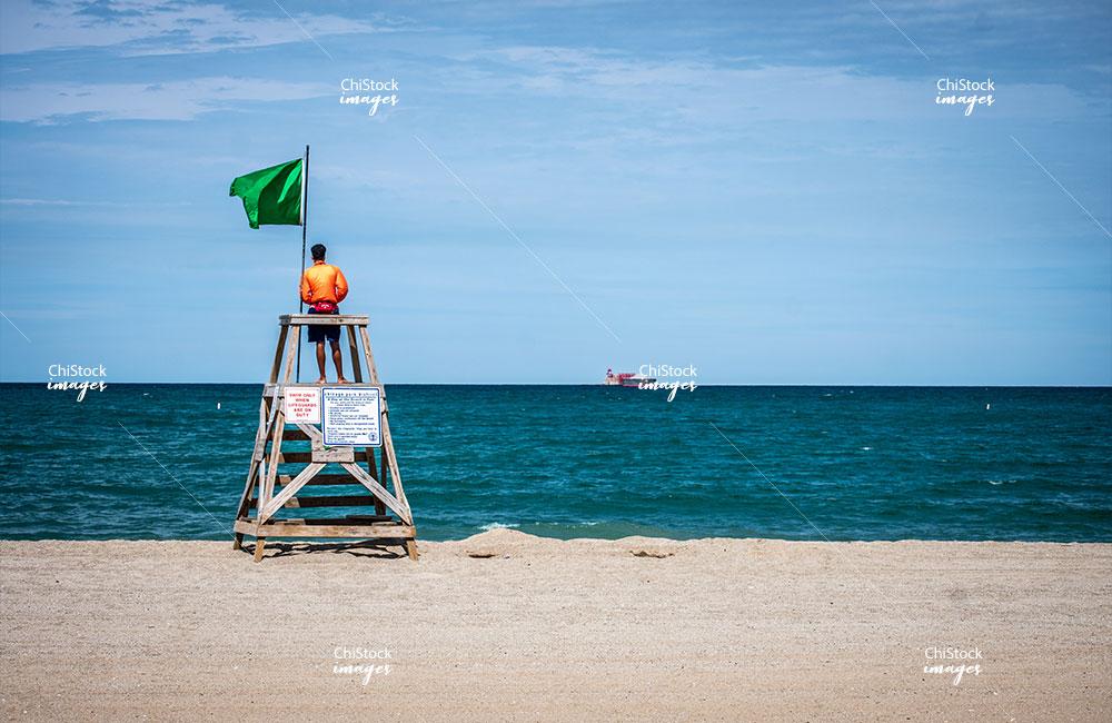 Lifeguard at the South Shore Rainbow Beach with Lake Michigan