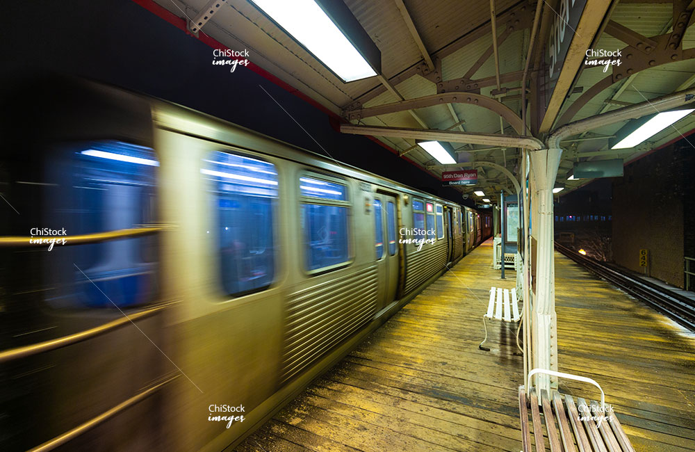 Sheridan CTA L Platform With Red Line Train Passing By on a Winter Night in Lakeview Chicago