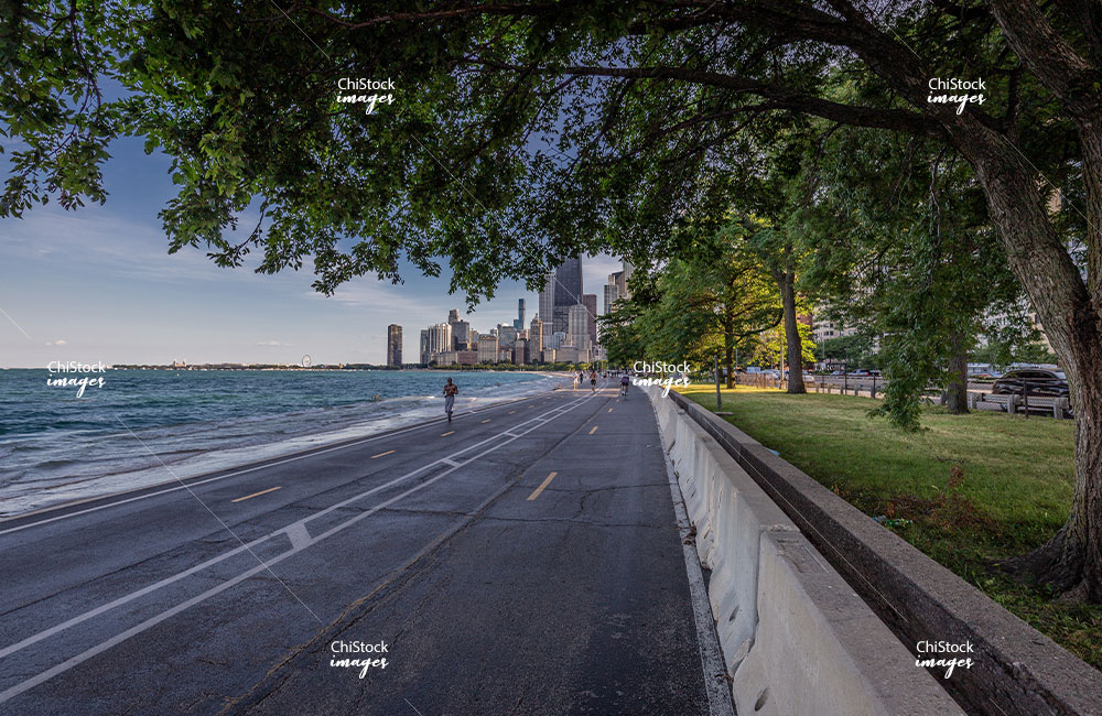 Runner at the Lakefront Trail in Near North Side, with Chicago Skyline in Background
