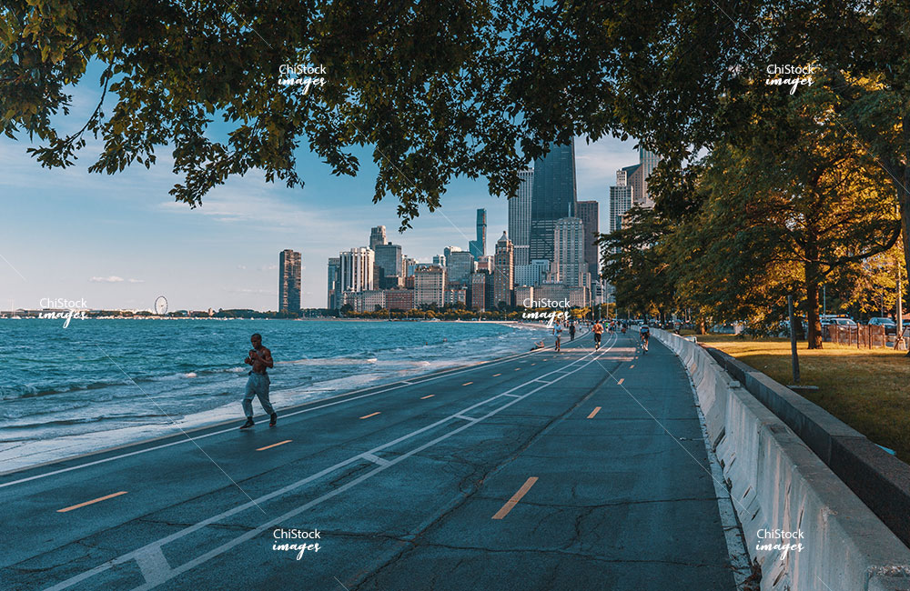 People at the Lakefront Trail in Near North Side, with Chicago Skyline in Background