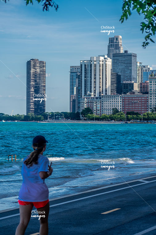 Runners at the Lakefront Trail in Near North Side, with John Hancock Center in Background