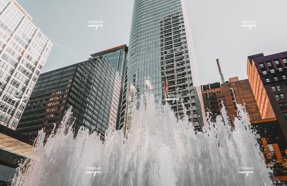 Residential and Office Buildings near a Water Fountain in Downtown Chicago