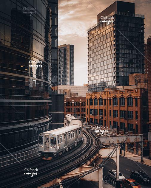 CTA Train Between River North High-Rise Buildings