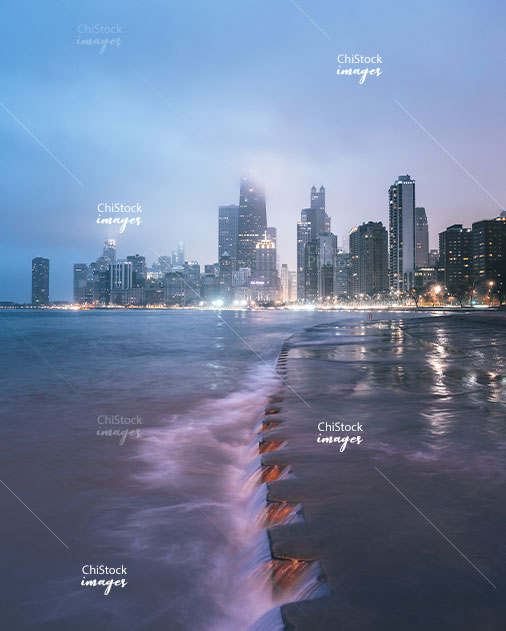 Chicago Skyline at Night With Stormy Waves on Lake Michigan