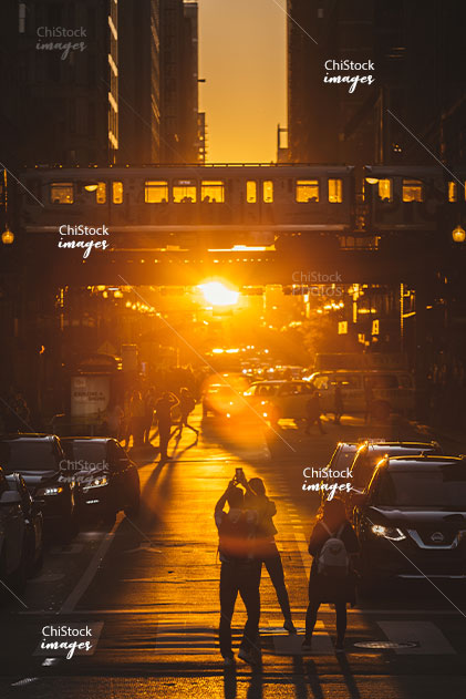 People Taking Photos of Street Traffic and CTA During The Chicago Golden Hour